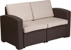 chocolate-brown-faux-rattan-loveseat-with-all-weather-beige-cushions rentals