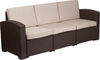 chocolate-brown-faux-rattan-sofa-with-all-weather-beige-cushions rentals